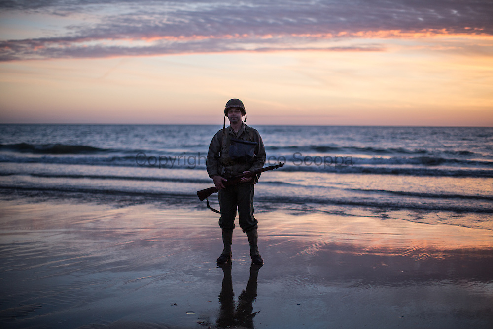 Reenactor posing for pictures on Omaha beach in the early morning of the 6th of June, exactly 70 year later the D-Day