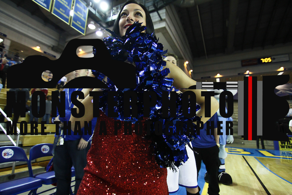 A member of the Philadelphia 76ers Dream Team stands at attention during the sing of the American National Anthem prior to a NBA D-league regular season basketball game between the Delaware 87ers (76ers) and Springfield Armor (Brooklyn Nets) Friday, Apr. 04, 2014 at The Bob Carpenter Sports Convocation Center, Newark, DEL.