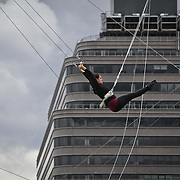Student Ariel Flavin practices a trick at Trapeze School New York during the June 4th morning class. The two hour beginner session taught the nine students in attendance the basics of flying trapeze -- including knee hangs and backwards somersaults -- in their facility on the roof of Pier 40...CREDIT: Daniella Zalcman for The Wall Street Journal.SLUG: NYMETROMONEY_Trapeze
