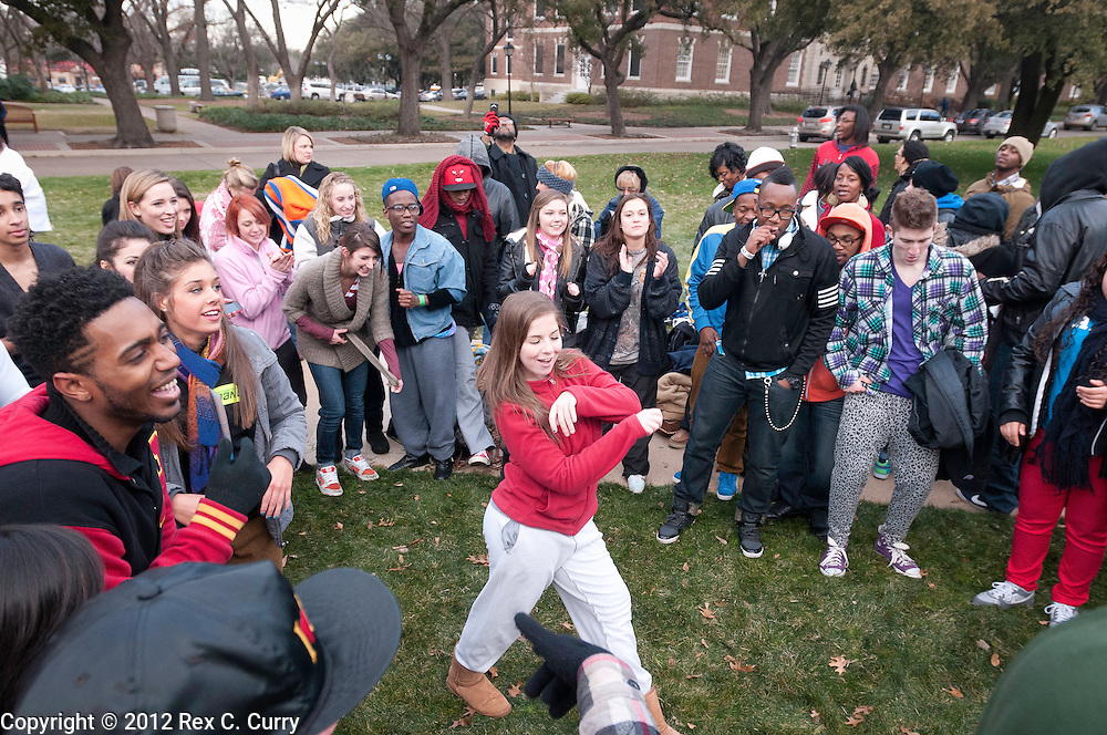 """Sarah Macaluso, 18, from the Woodlands, Tx.. is filmed for a production crew while waiting in the early morning cold to audition for """"So You Think You Can Dance"""" at SMU on Friday, Jan. 13, 2012."""
