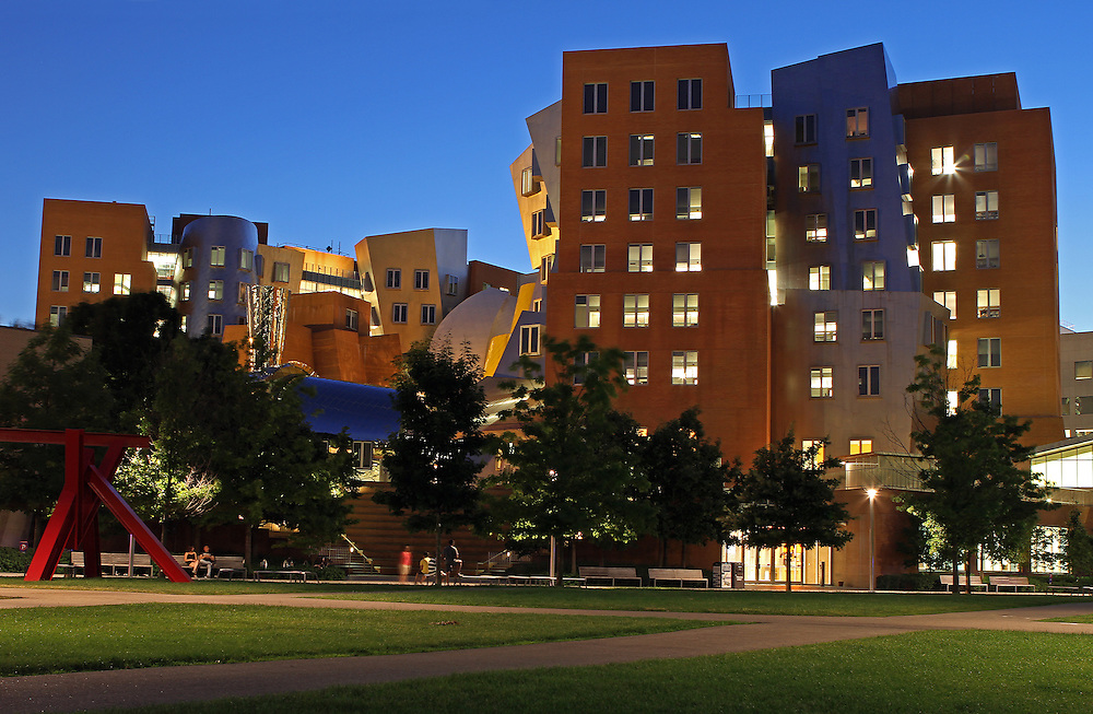 Cambridge, MA summer night photography of the Ray and Maria Stata Center with the red Mark di Suvero sculpture, Aesops Fables II. The Stata is a Massachusetts Institute of Technology academic complex designed by Pitzker Prize winning architect Frank Gehry. Building 32 is controversy among architects and while some think it is an architectural disaster, Boston Globe architecture columnist Robert Campbell wrote a glowing appraisal of the building in 2004 stating &quot;The Stata is always going to look unfinished. It also looks as if it's about to collapse. Columns tilt at scary angles. Walls teeter, swerve, and collide in random curves and angles. Materials change wherever you look: brick, mirror-surface steel, brushed aluminum, brightly colored paint, corrugated metal. Everything looks improvised, as if thrown up at the last moment. That's the point. The appearance of the Stata is a metaphor for the freedom, daring, and creativity of the research that's supposed to occur inside it.&quot;<br /> <br /> Skyline photos of Boston are available as museum quality photography prints, canvas prints, acrylic prints or metal prints. Prints may be framed and matted to the individual liking and decorating needs:<br /> <br /> http://juergen-roth.artistwebsites.com/featured/the-stata-juergen-roth.html<br /> <br /> Good light and happy photo making!<br /> <br /> My best,<br /> <br /> Juergen<br /> http://www.exploringthelight.com<br /> http://www.rothgalleries.com<br /> @NatureFineArt<br /> http://whereintheworldisjuergen.blogspot.com/<br /> https://www.facebook.com/naturefineart