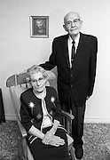 The Millers pose for their 60th wedding anniversary in the parlor of their Bartlesville, Okla., home. The Examiner-Enterprise, where I worked, honored such  anniversaries with a picture in the paper, but this couple was too infirm to come to our second-floor studio.