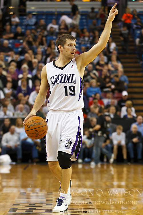 March 7, 2011; Sacramento, CA, USA;  Sacramento Kings point guard Beno Udrih (19) calls a play while dribbling the ball against the Houston Rockets during the third quarter at the Power Balance Pavilion. Houston defeated Sacramento 123-101.