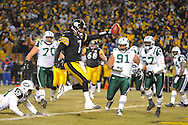 PITTSBURGH, PA - JANUARY 23: Ben Roethlisberger #7 of the Pittsburgh Steelers runs for a touchdown during the second quarter against the New York Jets in the AFC Championship Playoff Game at Heinz Field on January 23, 2011 in Pittsburgh, Pennsylvania. The Steelers defeated the Jets 24 to 19. (Photo by: Rob Tringali) *** Local Caption *** Ben Roethlisberger