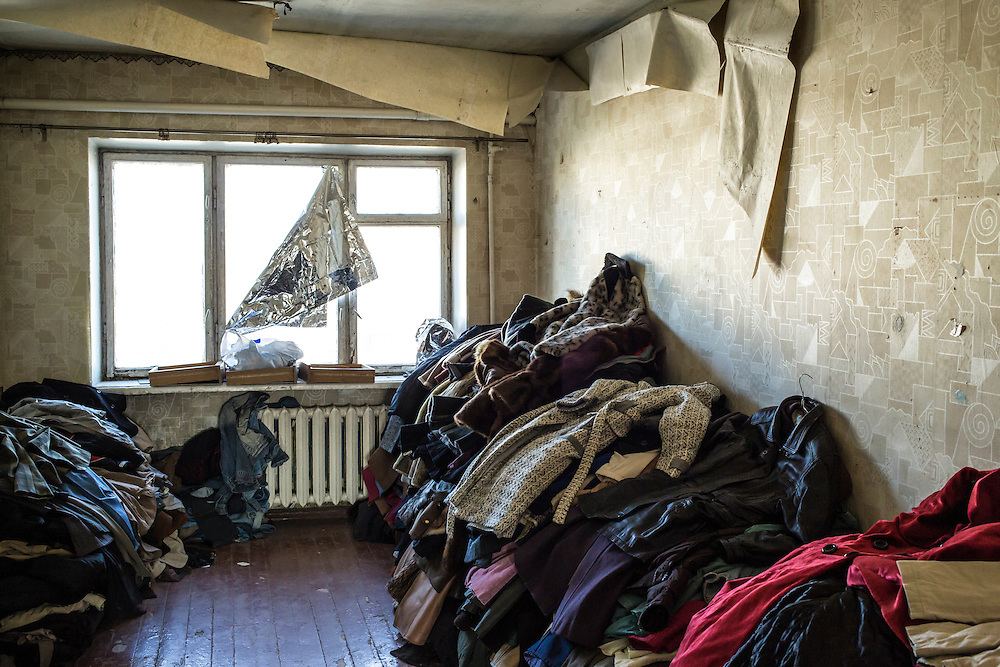 DNIPROPETROVSK, UKRAINE - OCTOBER 10: Dozens of donated winter coats are available for people who fled with few belongings at The Aid of Dnipro, a charity organization providing assistance to displaced people from Eastern Ukraine, on October 10, 2014 in Dnipropetrovsk, Ukraine. While the charity has received many donations of clothes and toys, they are having a difficult time providing enough food to those in need. The United Nations has registered more than 360,000 people who have been forced to leave their homes due to fighting in the East, though the true number is believed to be much higher. (Photo by Brendan Hoffman/Getty Images) *** Local Caption ***
