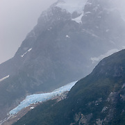 Visit glaciers on Last Hope Sound (Seno de Última Esperanza) via ferry from Puerto Natales, Chile, South America. Última Esperanza Sound is an ocean inlet stretching from the mouth of Eberhard Fjord to Monte Balmaceda within Magallanes Basin. Filling a valley carved by ice age glaciers, this inlet is a tidewater river which drains an extensive basin including almost all the surface waters of Torres del Paine National Park through the Serrano River.