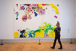 Visitor looking at painting, My Shell Angel by Sam Francis,    at new Museum Barberini in Potsdam Germany
