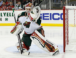 Mar 20, 2009; Newark, NJ, USA; Minnesota Wild goalie Niklas Backstrom (32) makes a glove save during the second period of their game against the Devils at the Prudential Center.