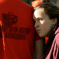An unidentified Virginia Tech student leans on a fellow students shoulder with a VT slogan on his shirt at Virginia Tech in Blacksburg, Virginia April 17, 2007.  REUTERS/Rick Wilking (UNITED STATES)