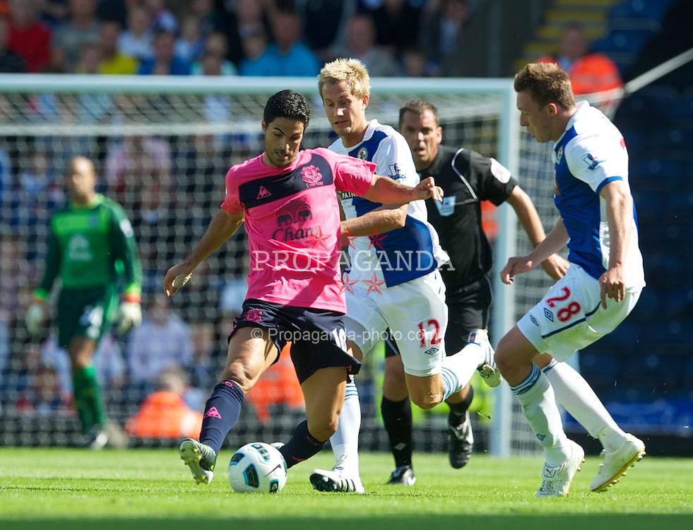 BLACKBURN, ENGLAND - Saturday, August 14, 2010: Everton's Mikel Arteta and Blackburn Rovers' Morten Gamst Pedersen during the Premiership match at Ewood Park. (Pic by: David Rawcliffe/Propaganda)
