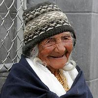 South America, Ecuador, Calderon. Smiling elderly Quechuan woman in Calderon, a small Andean town outside of Quito.