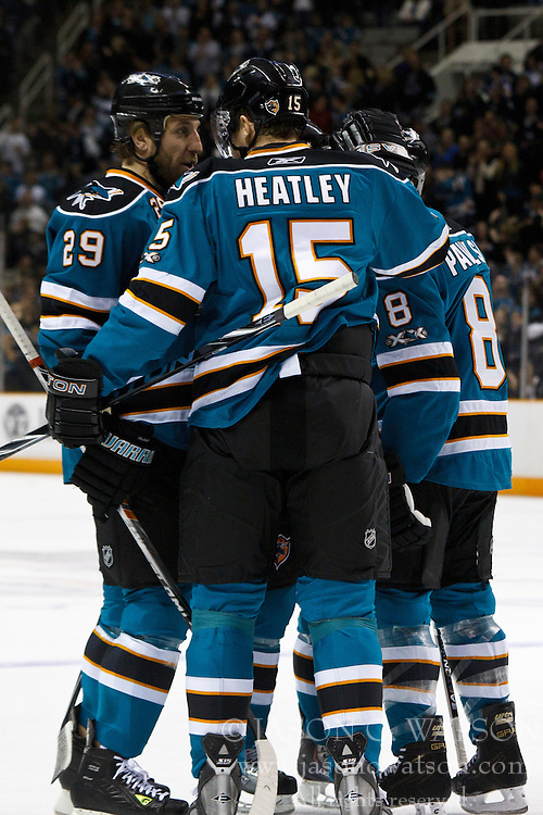 March 12, 2011; San Jose, CA, USA;  San Jose Sharks right wing Ryane Clowe (29) is congratulated by teammates after scoring a goal against the New York Rangers during the first period at HP Pavilion. New York defeated San Jose 3-2 in shootouts. Mandatory Credit: Jason O. Watson / US PRESSWIRE