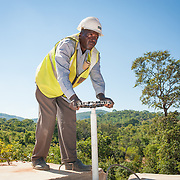 CAPTION: Isaac checks a junction box, part of the Kufandada River Protection and Irrigation Scheme Project. LOCATION: Bikita District, Masvingo Province, Zimbabwe. INDIVIDUAL(S) PHOTOGRAPHED: Isaac Magara.