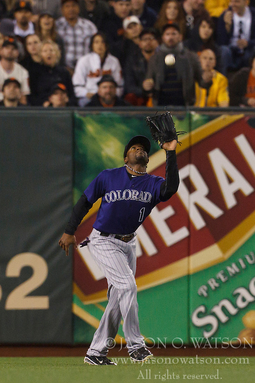 Sep 26, 2011; San Francisco, CA, USA;  Colorado Rockies left fielder Eric Young Jr. (1) catches a fly ball against the San Francisco Giants during the third inning at AT&T Park.
