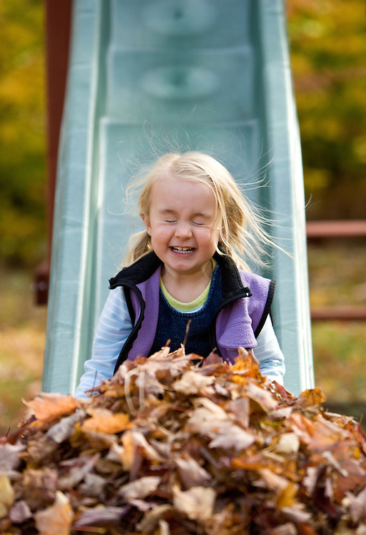 Addy Budliger has some fun playing in the autumn leaves outside her home in northern Vermont.