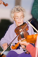 Senior woman fiddler, Alberta Wood, Montana Old Time Fiddlers Picnic, Livingston, Montana, <br /> MODEL RELEASED PURPLE LADY ONLY