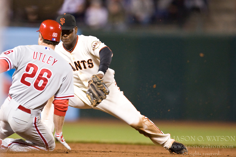 April 27, 2010; San Francisco, CA, USA;  San Francisco Giants shortstop Edgar Renteria (16) tags out Philadelphia Phillies second baseman Chase Utley (26) during the ninth inning at AT&T Park. San Francisco defeated Philadelphia 6-2.