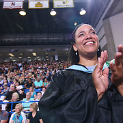 Thomas McKean High School faculty members Shalina Spurlock participate in a graduation processional during McKean 49th commencement exercises Saturday, June 06, 2015, at The Bob Carpenter Sports Convocation Center in Newark, Delaware.