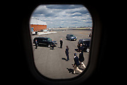 Secret Service agents stand watch as campaign staffers leave GOP presidential candidate Gov. Mitt Romney's chartered plane in Newark, New Jersey, June 26, 2012.