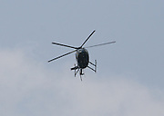Police helicopter flying towards the photographer.