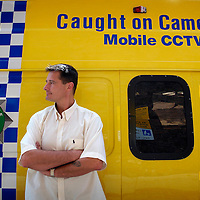 UK. Liverpool. Professional 'Streaker' Mark Roberts in front of a police mobile cctv van round the corner from Liverpool Docks..Photo©Steve Forrest/Workers' Photos.