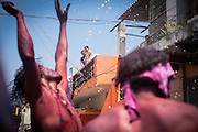 Indians celebrating holi festival  in the streets of Hampi, Karnataka, India, on  March 5, 2015. Holi, also known as the Festival of Colors, heralds the beginning of spring and is celebrated all over India.<br />