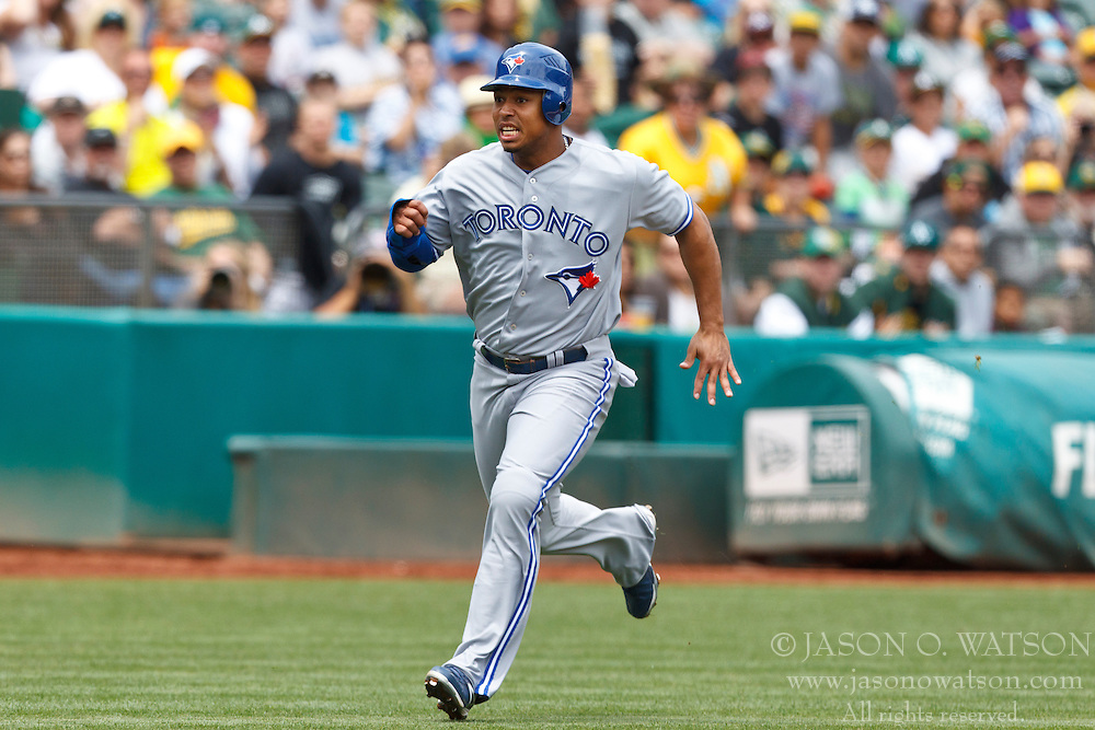 OAKLAND, CA - AUGUST 04: Moises Sierra #14 of the Toronto Blue Jays runs towards home plate against the Oakland Athletics during the second inning at O.co Coliseum on August 4, 2012 in Oakland, California. The Toronto Blue Jays defeated the Oakland Athletics 3-1 in eleven innings. (Photo by Jason O. Watson/Getty Images) *** Local Caption *** Moises Sierra
