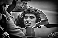 Here, 1971 US Grand Prix winner, Francois Cevert listens intently to ELF Team Tyrrell-Ford designer Derek Gardner as they try to find the best compromise for the suspension set-up of the new ELF Team Tyrrell-Ford 005 during the United States Grand Prix at Watkins Glen, NY.<br />