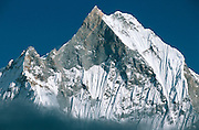 """Machapuchare 6993m (22,943ft), West Face from Annapurna Base Camp, Nepal.  Sacred to the god Shiva, the peak is forbidden to climbers, and has never officially been summited.  It is commonly known as the """"Matterhorn of Nepal"""" or the """"Fish's Tail"""".  Nikon F90, 80-200/2.8, Agfa CT100.  Photo: 2 November 1993."""