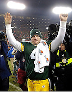 (2004)-Green Bay's Brett Favre walks off the field after beating the St. Louis Rams on Monday night Football.