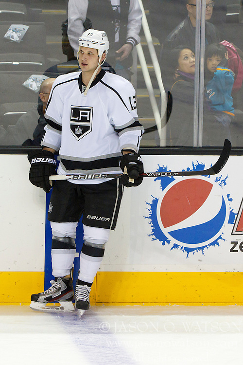 Dec 23, 2011; San Jose, CA, USA; Los Angeles Kings left wing Kyle Clifford (13) warms up before the game against the San Jose Sharks at HP Pavilion. San Jose defeated Los Angeles 2-1 in shootouts. Mandatory Credit: Jason O. Watson-US PRESSWIRE