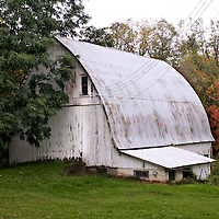 A collection of Barns that still can be seen while traveling the countryside in  the beautiful State of Wisconsin.<br /> Pepin County- white barn, County Road J east of State Hwy 35.