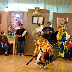 120813       Brian Leddy.A dancer performs at the Inter-Tribal Indian Ceremonial offices during the December ArtsCrawl. This month the office will again feature traditional dancers and drummers.