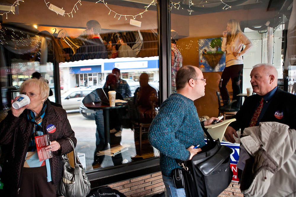 People stand outside a coffee shop where Republican presidential candidate Rick Perry was speaking at a campaign meet and greet on Sunday, December 11, 2011 in Ames, IA.