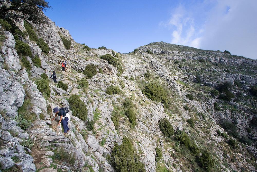 People hiking on La Concha  mountain in Marbella, Andalucia, Spain