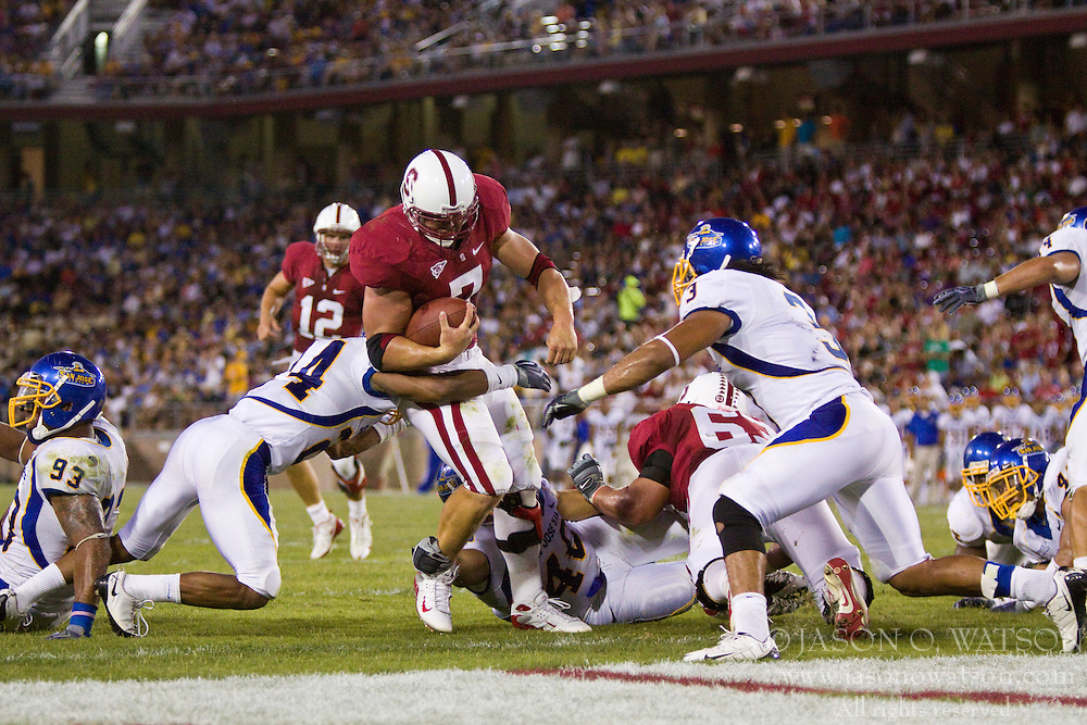 September 19, 2009; Stanford, CA, USA;  Stanford Cardinal running back Toby Gerhart (7) scores a touchdown on a 1 yard rush in the second quarter of the San Jose State Spartans game at Stanford Stadium.