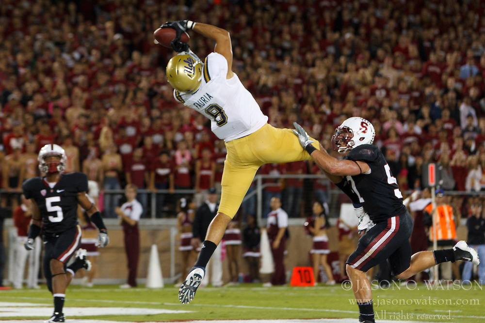 Oct 1, 2011; Stanford CA, USA;  UCLA Bruins tight end Joseph Fauria (8) catches a pass for a touchdown against the Stanford Cardinal during the second quarter at Stanford Stadium. Mandatory Credit: Jason O. Watson-US PRESSWIRE