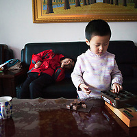 Beijing, March 11 : Tian Peng, 15, lies on the sofa while his little brother Tian Ye, 3, plays in the apartment.<br /> As a baby Tian Peng fell ill with brain   hemorrhage supposedly due to a lack of vitamin K. When Tian Peng was a kid, friends advised the parents to simply abandon him as there's neither enough help nor support in China apart from a small NGO. Tian is unable to speak, think, walk and needs help for everything.<br /> Chinese attitudes towards people with disabilities have improved in recent years, but the support of society and opportunities in education and employment are scarce.