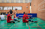 2016/06/07 &ndash; Bogotá, Colombia: Jonathan Fontes, 35, trains passing against a wall with his team mates during a training session at the High Performance Complex, Bogotá, 7th June 2016.<br /> -<br /> Jonathan is a retired soldier of the Colombian army. In 2012, he stepped on an anti-personnel mine during a routine round in the Caqueta department, losing his right leg. At the beginning the process of recuperation was difficult, since he felt he was totally dependent on others. <br /> At first he started to focus on weightlifting sports, but found he was too tall. He was recommend to try seated volleyball, a sport that until then was unknown to him. Nowadays, he is the Captain of the Colombian team. The dream is to arrive to the Rio 2016 Paralympic games, but the national team only started to play the sport for the first time in 2011. <br /> The Colombian Volleyball net team finished 4th in the Pan-American Games of Toronto in 2015. Unfortunately they needed to have finished 2nd in order to qualify for a spot on this year Paralympics. Jonathan believes it still isn&rsquo;t the right time and that they have much more to learn. Instead they aim to work hard and be on the next Paralympics in Tokyo 2020. (Eduardo Leal)