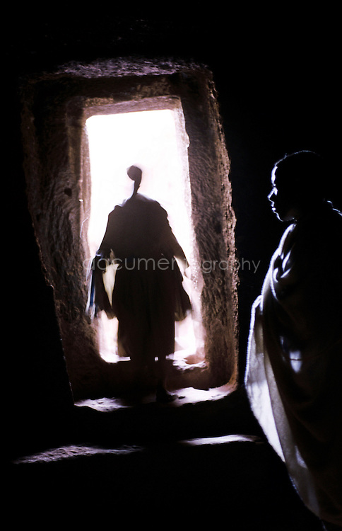 A pilgrim walks into one of the many tunnels that connect the churches together.