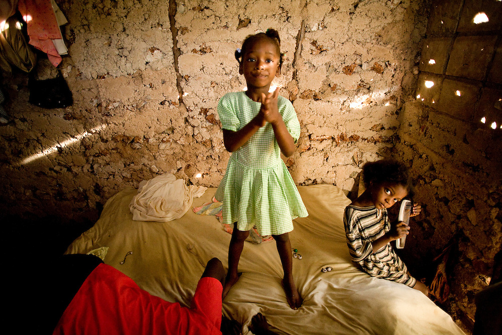 Girls get ready for school in their home.