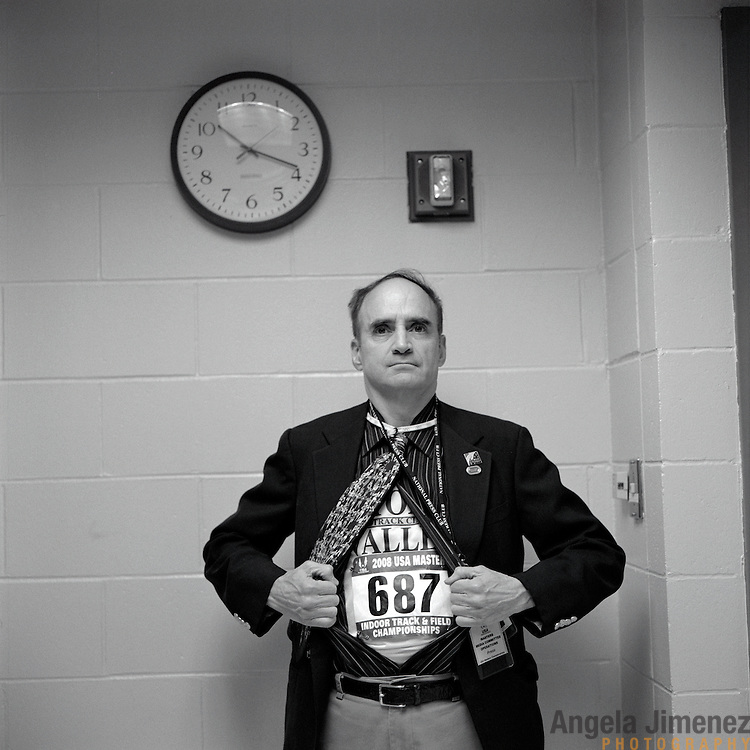 Runner (and communications director) Bob Weiner prepares to run the men's 60 year age bracket 1600 meters (mile) in the press booth at the 2008 USA Master's Indoor Track & Field Championships in Boston, Massachusetts. March, 2008.