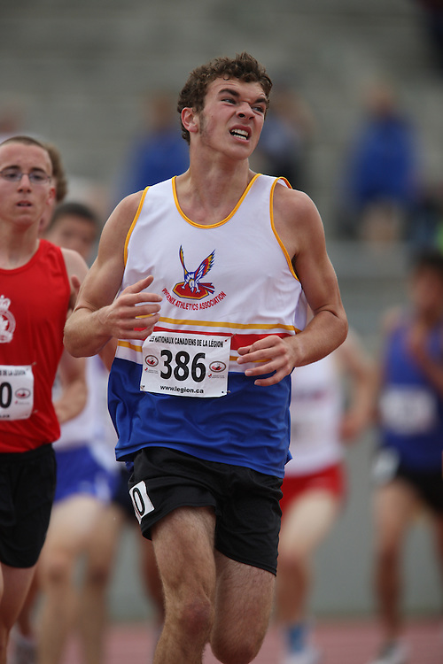 Sherbrooke, Quebec ---09/08/09---  Eamonn Kichuk of Phoenix Athletics Assoc. competes in the 3000 metres at the 2009 Legion Canadian Youth Track and Field Championships in Sherbrooke, Quebec, August 10, 2009..HO/ Athletics Canada (credit should read GEOFF ROBINS/Mundo Sport Images/ Athletics Canada)..