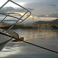 Cloudy sunset at sport port Marina Botafoch, of Ibiza, Spain, with sailboats and fishing boats in view