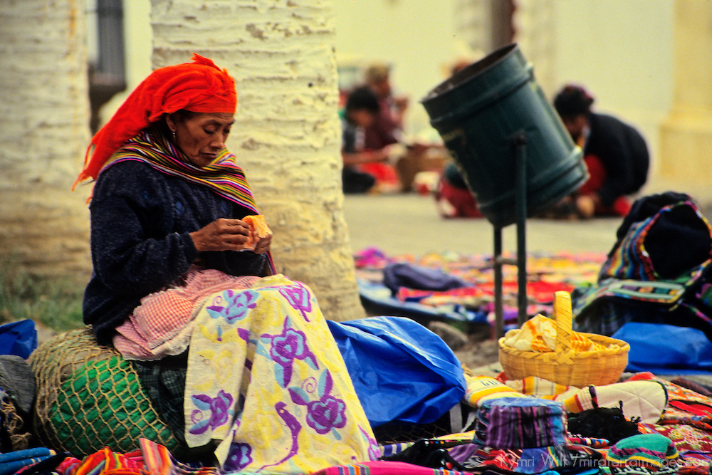 Central America, Guatemala, Antigua. A Guatemalan woman crafts her small textile to sell on the streets of Antigua, Guatemala.