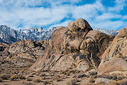 The eastern Sierras and Mount Whitney are in the background. This location served as a background to hundreds of Hollywood movies. Alabama Hills, Near Long Pine California.