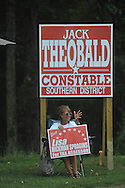 Lisa Spragins, tax assessor candidate, holds a sign outside the Chamber of Commerce in Oxford, Miss. on Tuesday, Aug. 23, 2011. Mississippians are going to the polls today to vote in primary runoffs in state and local elections.