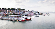 The Red Jet passenger ferry alongside at Town Quay in the Medina River in Cowes on the Isle of Wight. <br /> The fast ferry carries foot passenger between the island and Southampton in 25 minutes.<br /> Picture date: Monday August 17, 2015.<br /> Photograph by Christopher Ison &copy;<br /> 07544044177<br /> chris@christopherison.com<br /> www.christopherison.com