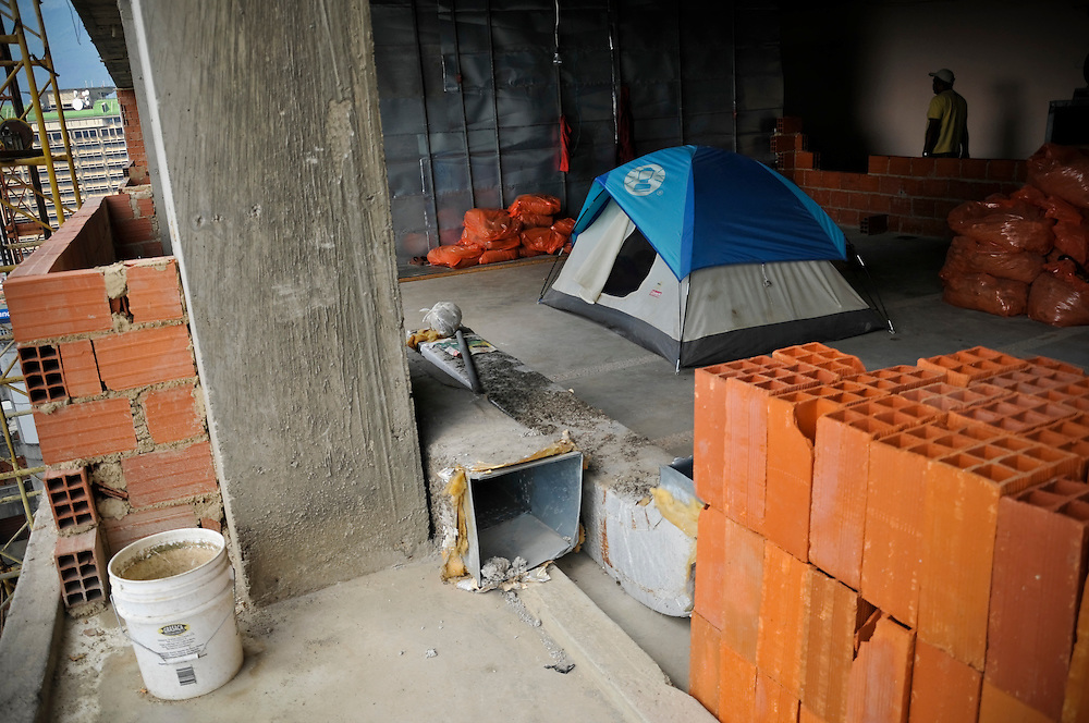 "A recently arrived squatter's tent on the 23rd floor of the ""Tower of David.""  New arrivals usually sleep in tents or hammocks while they are constructing their home in the space allotted to them by a community council that manages the 2,500 squatters that occupy the building.  Residents must pay approximately $35 per month for utilities, and participate in community service projects, but do not have to pay any other fees to live there."