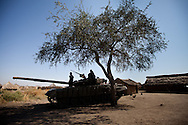 The gun of an SPLA tank is aimed at a Sudan Armed Forces division across the border at the most northern SPLA barracks in Upper  Nile State.